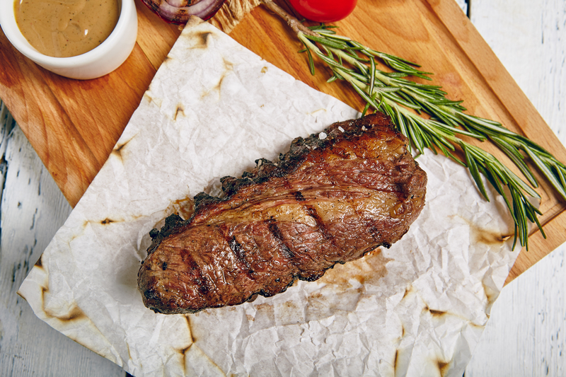 Beef Steak on Wooden Background