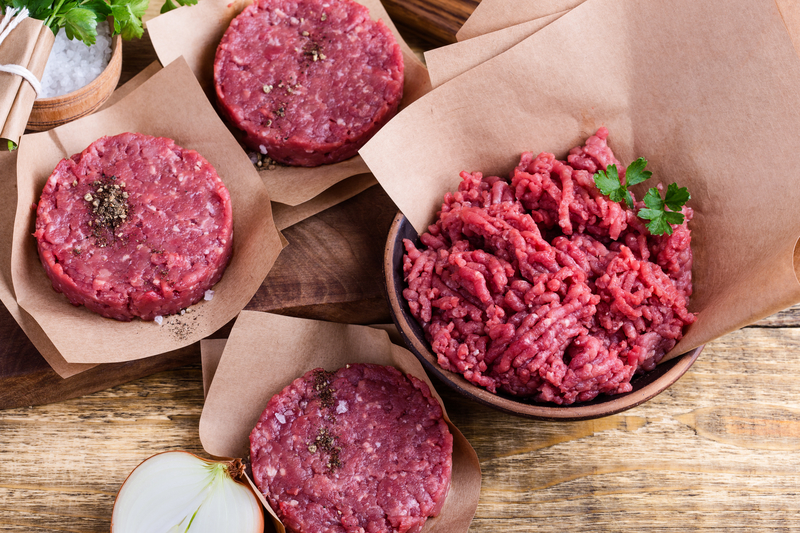 Organic raw ground beef meat and burger steak cutlets